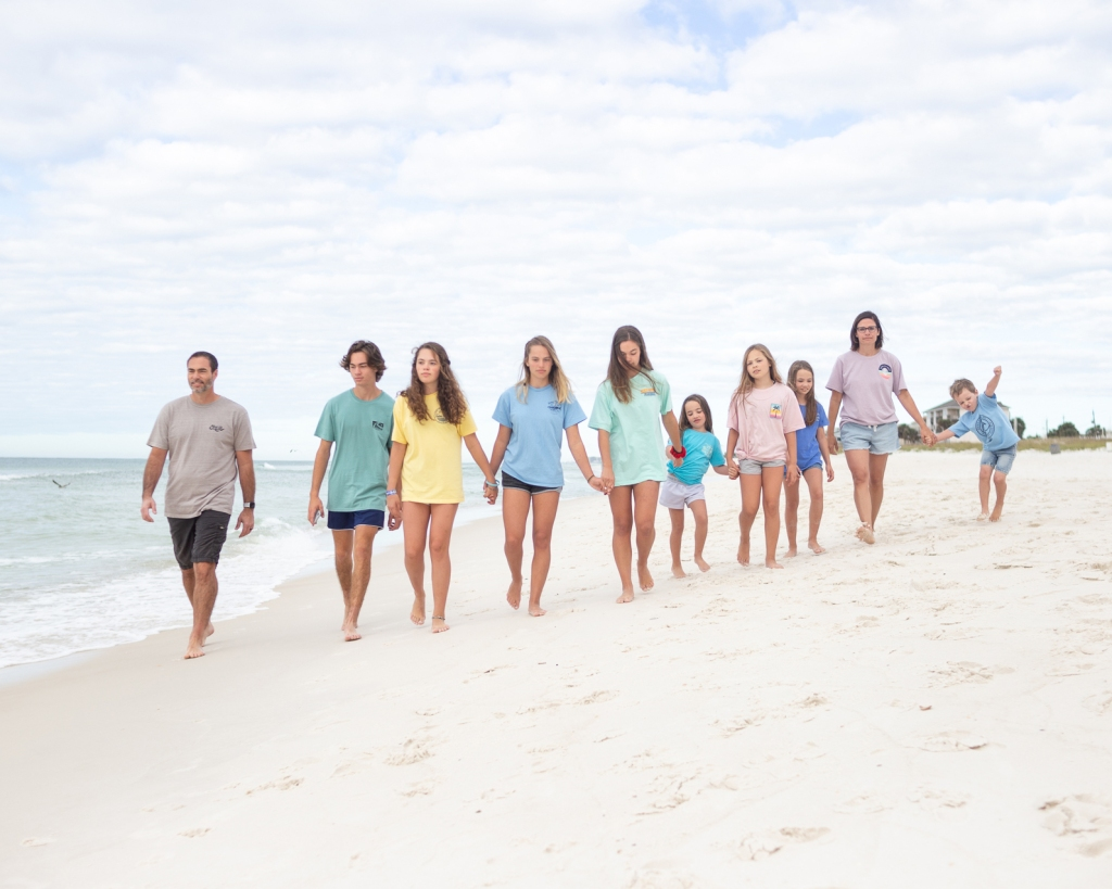 Brittany Curry, along with her husband, Brett Curry, and their kids vacation at the beach.