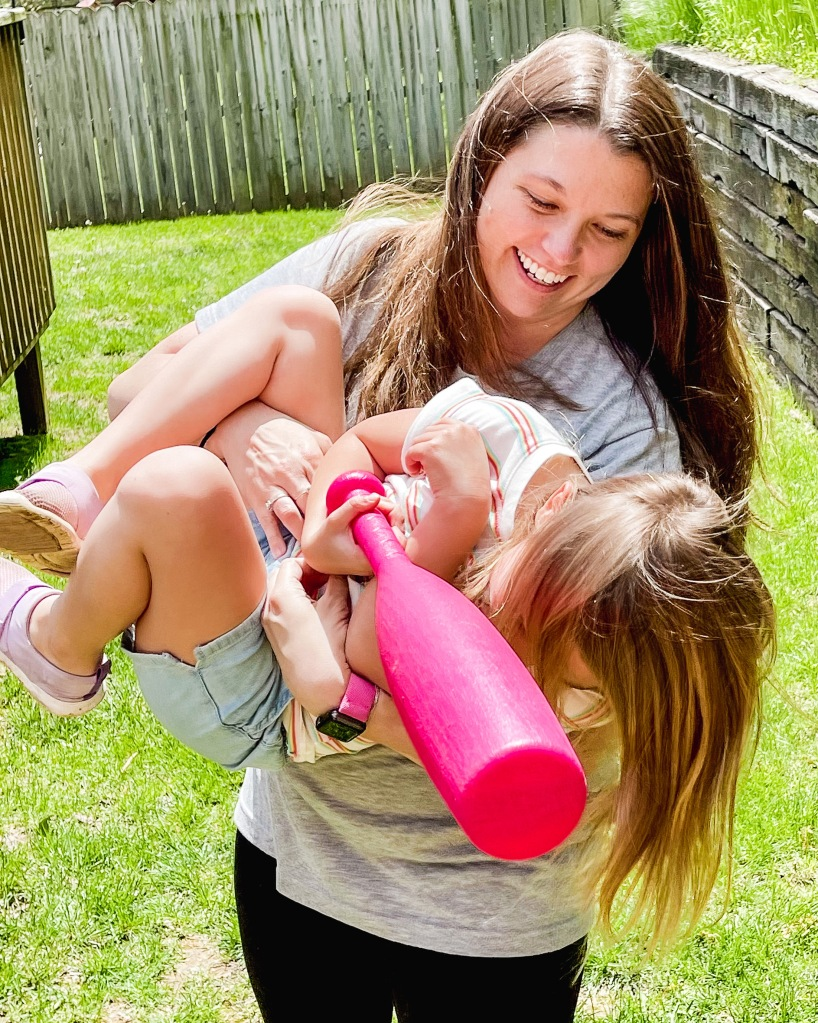 Early education teacher Mary Floyd plays with her daughter in Nixa, Missouri.