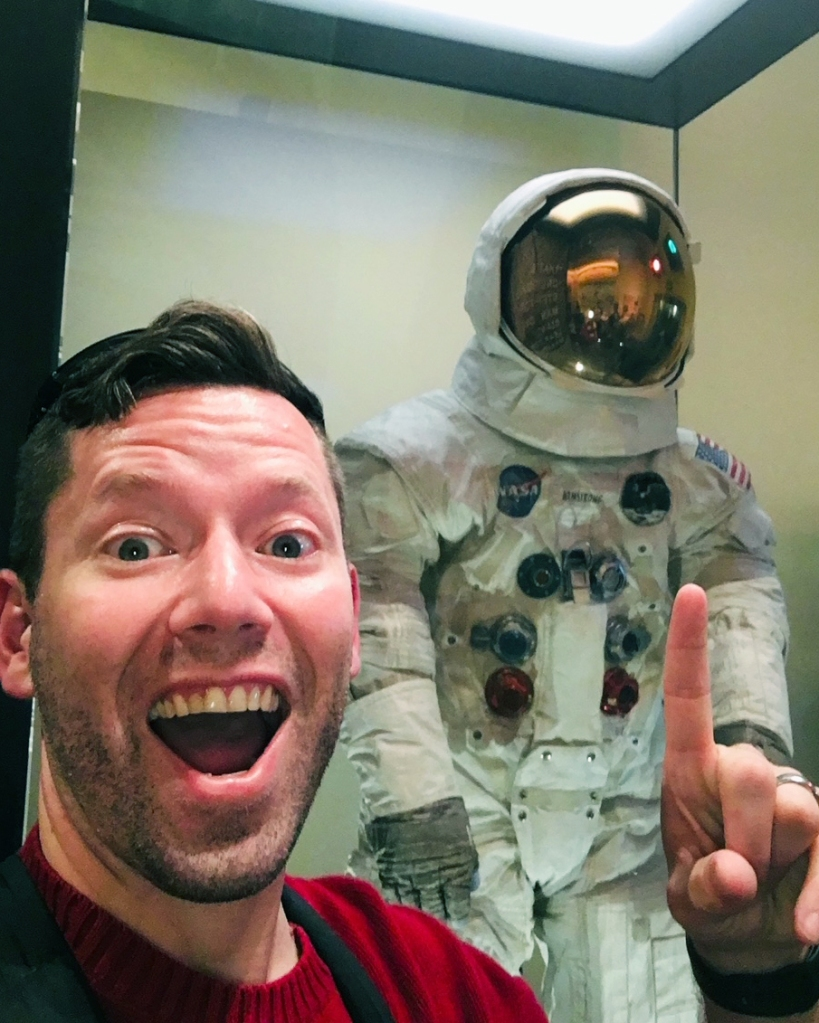 The Discovery Center's Rob Blevins poses with a faux astronaut while sharing the importance of play for adults and kids.
