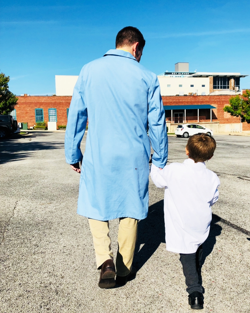 Rob Blevins walks hand-in-hand with a young scientist at The Discovery Center in Springfield, Missouri.