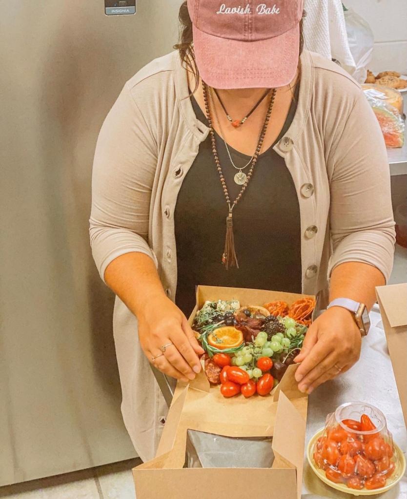 Kendra Hinkle creates a personalized, custom food grazing box at Lavish Grazing in Springfield, Missouri.