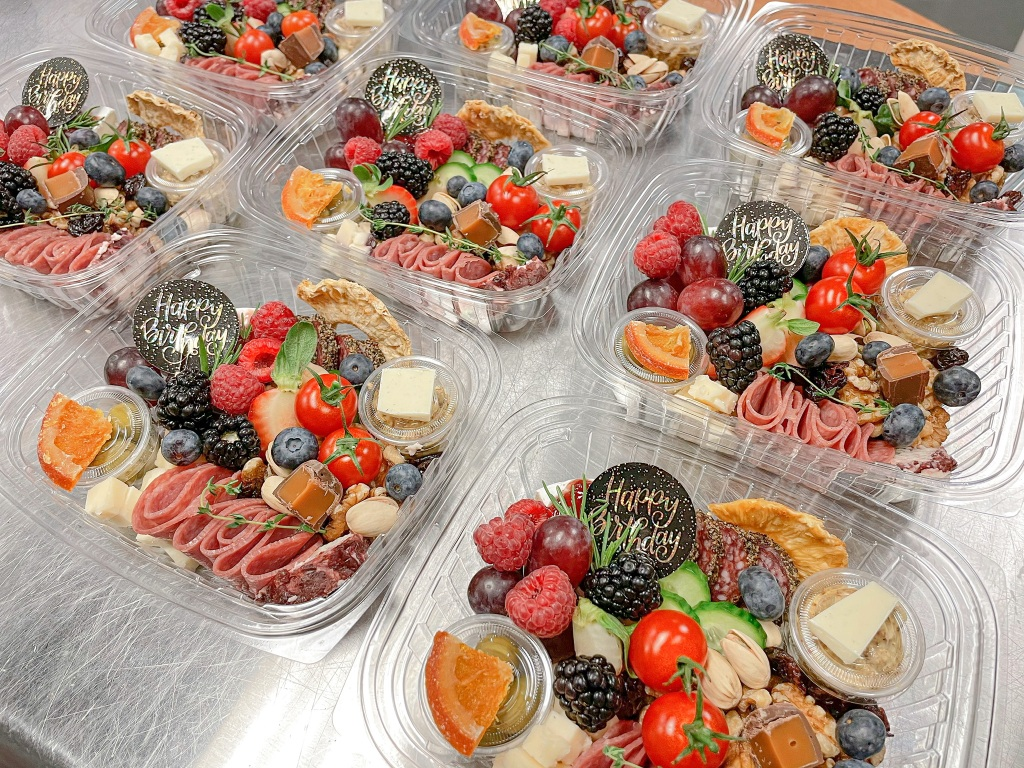 Individual, personalized, Happy Birthday charcuterie boxes for guests.